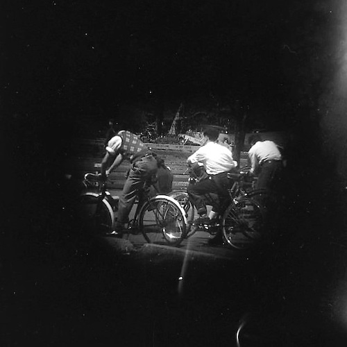 Boys on Bicycles before the Ten-Speed was invented (telescope view)