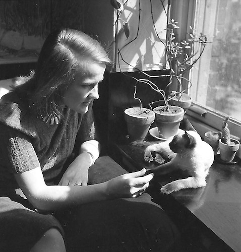 Wysse in her Apartment with her Cat