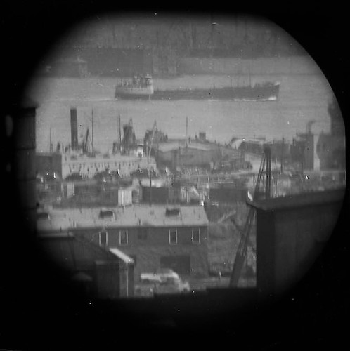 A Window on the East River (telescope view) X