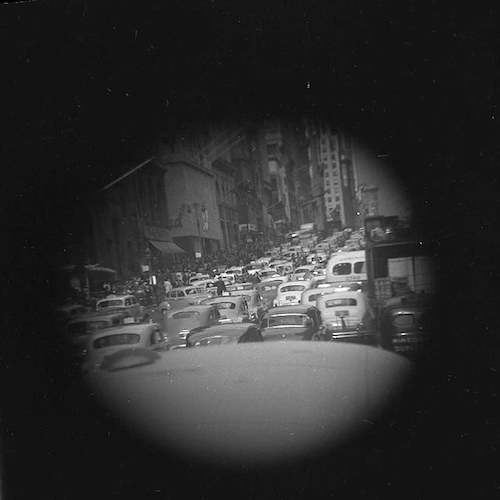 Fifth Ave. traffic congestion, with policeman (telescope view)