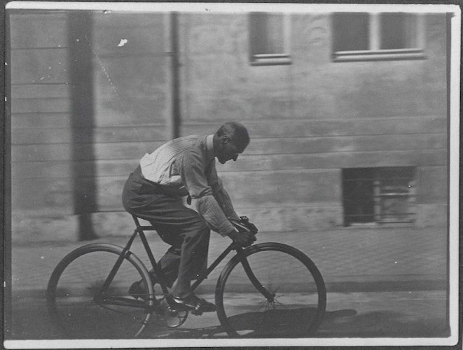 Lyonel Feininger on his bicycle in Gutenbergstrasse