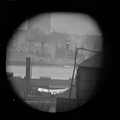 Cargo Steamer Coming up the East River (telescope view) (Brooklyn Across the East River)