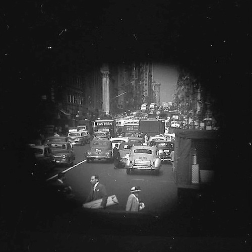 Fifth Ave. Traffic Congestion with Man Crossing (telescope view)