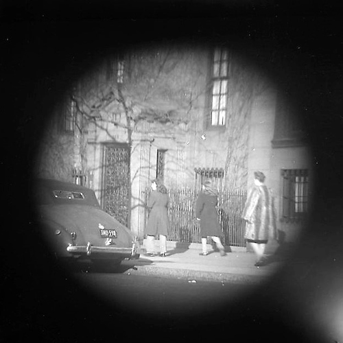 Women passing a parked Car - telescope view