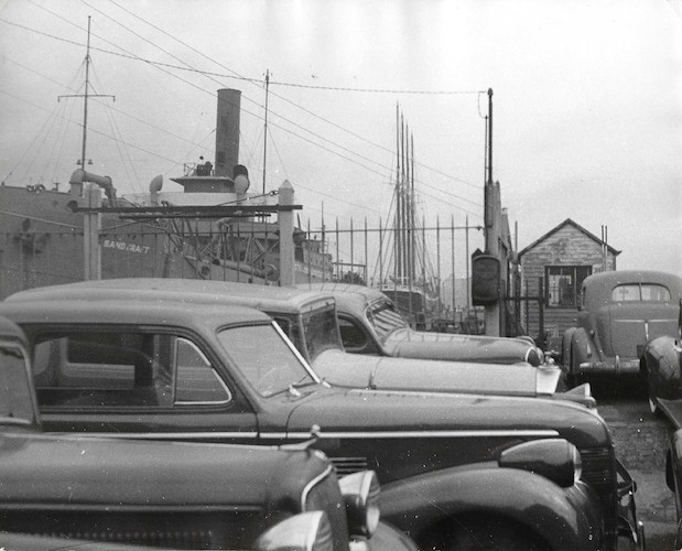Cars parked near an Esso Dealer